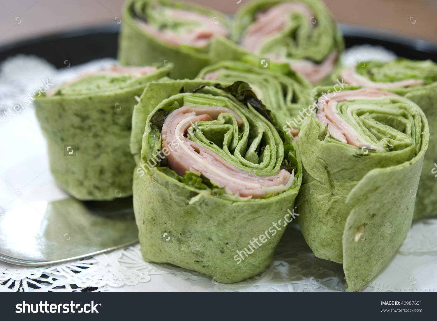 Ham And Spinach Wraps And A Spatula At A Buffet.