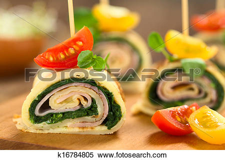 Stock Image of Crepe Rolls with Ham and Spinach k16784805.