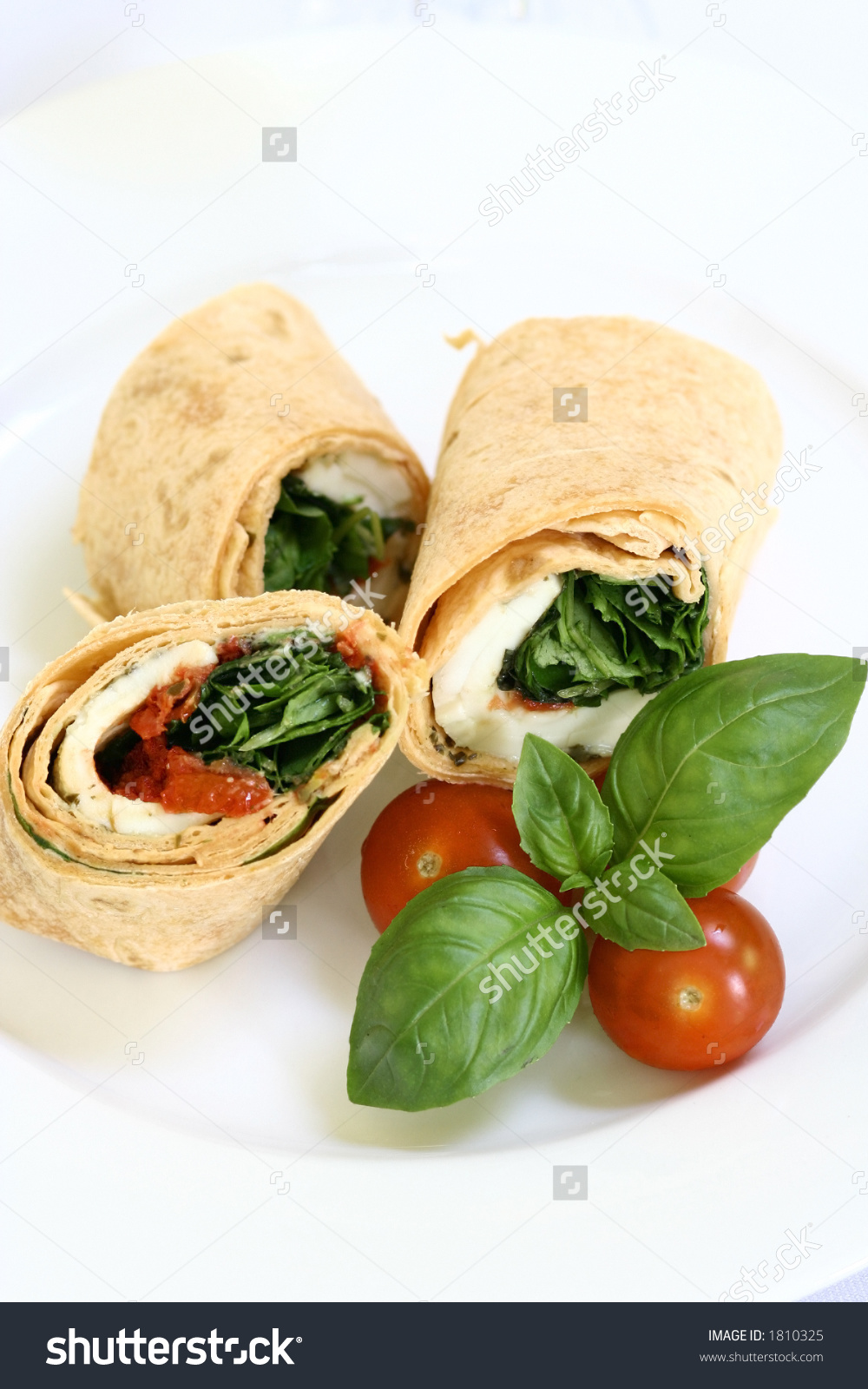A Plate Of Mozzarella And Spinach Tortilla Wrap Sandwich With.