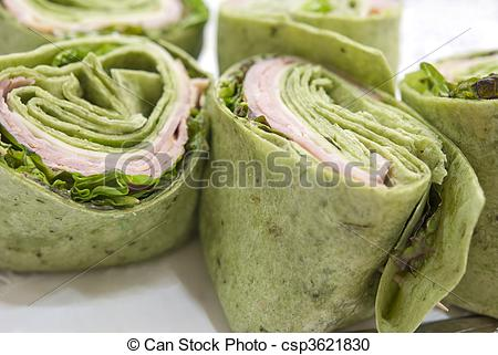 Stock Photography of Ham and spinach wraps on a serving platter.