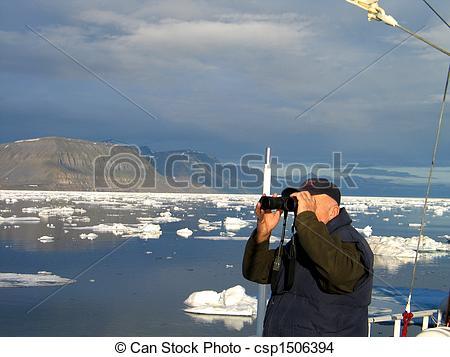 Stock Photo of Old man looking through binoculars Spitsbergen.