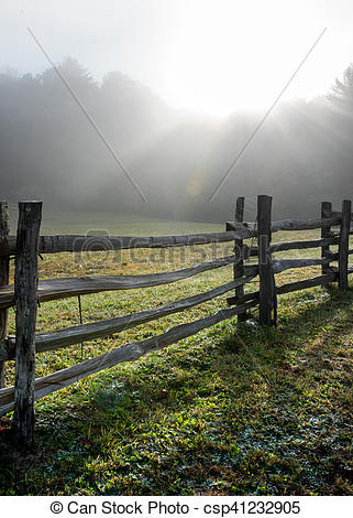 Stock Photography of Low Angle View of Split Rail Fence and Foggy.