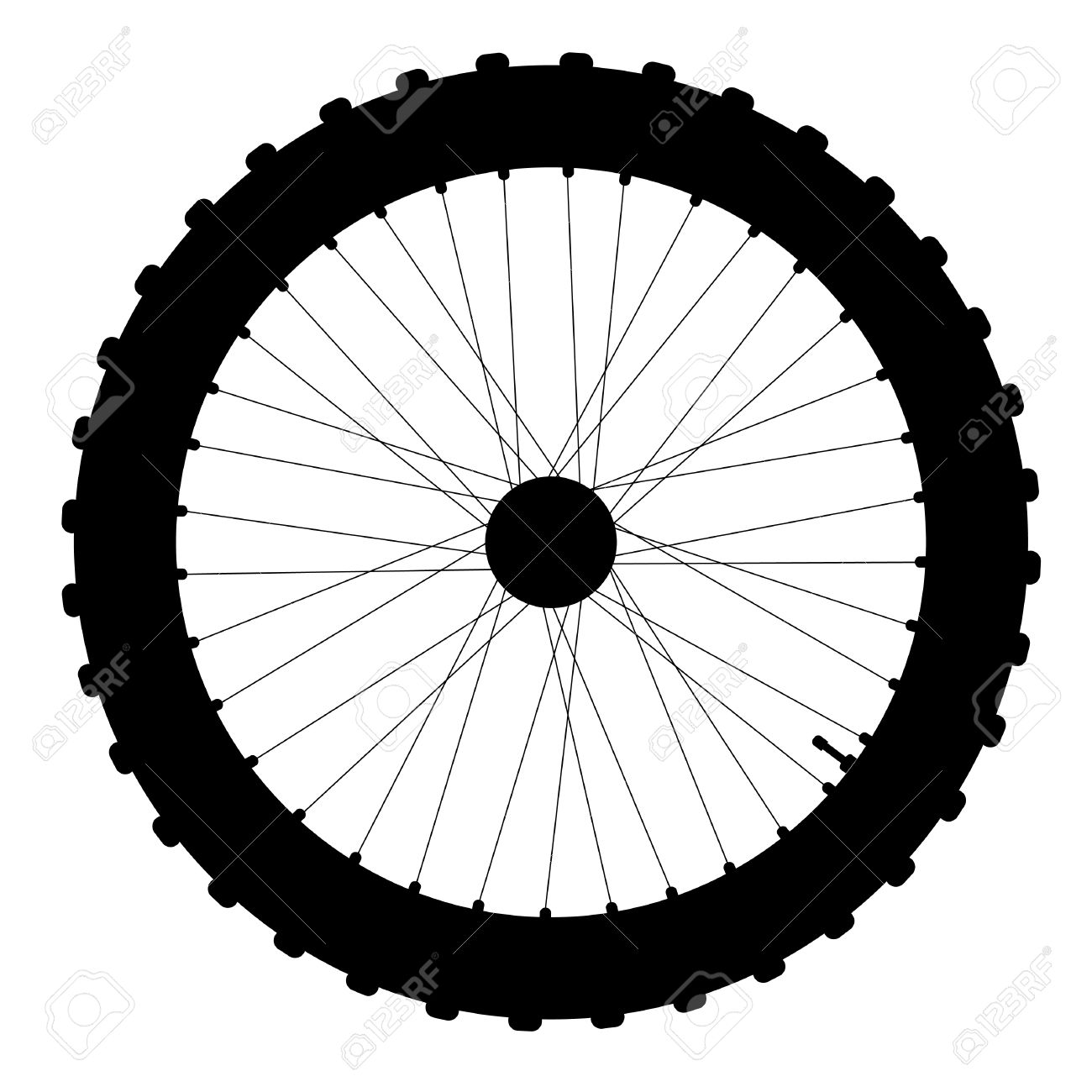 A Knobly Tyre On A Bicycle Wheel With Valve And Spoke Nipples.