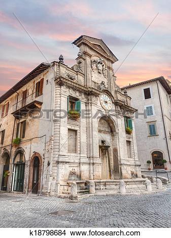 Stock Photo of fountain and clock tower in Spoleto, Italy.