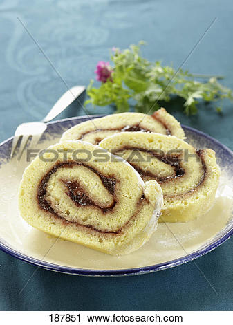Stock Photography of Rolled sponge cake with plum jam filling.