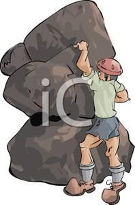 Man Wearing a Helmet Rock Climbing.