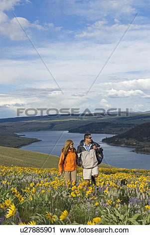 Stock Photography of A couple takes in the spectacular spring.