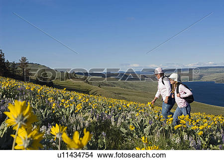 Stock Photo of A mother and daughter enjoy a hike through the.