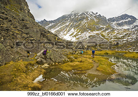 Stock Photography of family hiking along Reed Lakes Trail.