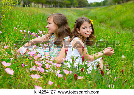 Picture of children friends girls on spring poppy flowers meadow.