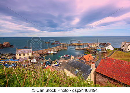 Stock Photographs of the harbour and village at St. Abbs in.