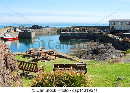 Picture of harbour, boat, seats and lifeboat shed at St. Abbs at.