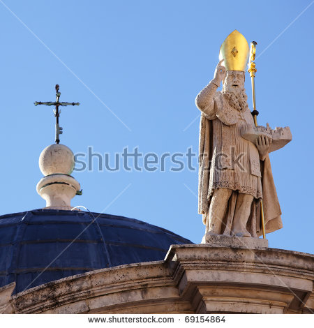 A Cross And Sculpture Of St. Blasius (Sveti Vlaho) Atop The Church.