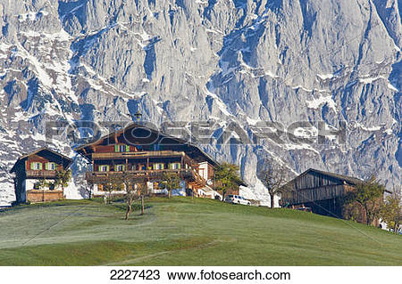 Stock Photo of Farmhouses on hill, St. Johann, Wilder Kaiser.