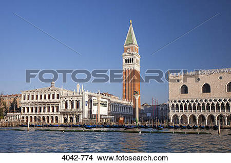 Stock Photo of Bell tower with palace at waterfront, St Mark's.