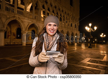 Stock Images of Happy woman tourist with smartphone on St. Mark's.