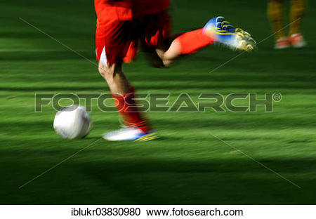 "Stock Photography of ""A football player's legs with a football."