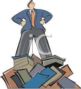 Man In a Suit Standing on Top of a Pile of Books Looking.