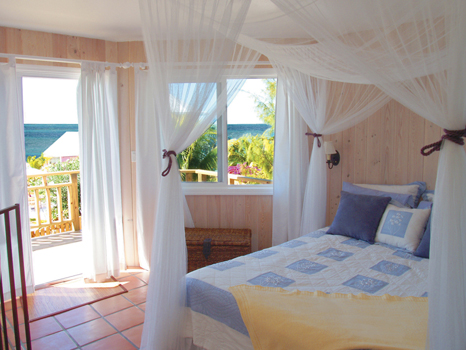 Master bedroom of the Periwinkle Bungalow at the Staniel Cay Yacht.