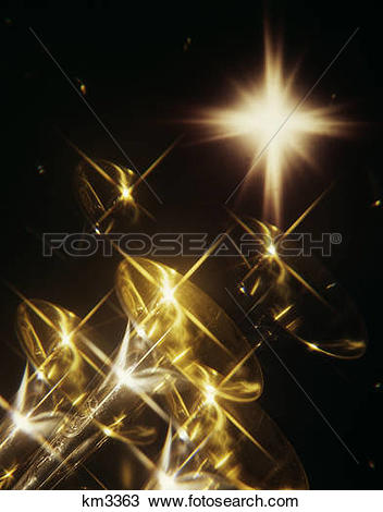 Stock Photo of 1970s multiple exposure of trumpets and spotlight.