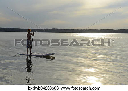 Stock Photo of Boy, stand up paddle boarding, SUP, St. Heinrich.