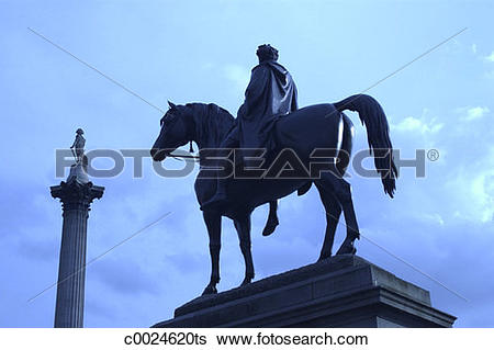 Stock Images of Blue tone of a statue of a man on a horse in.