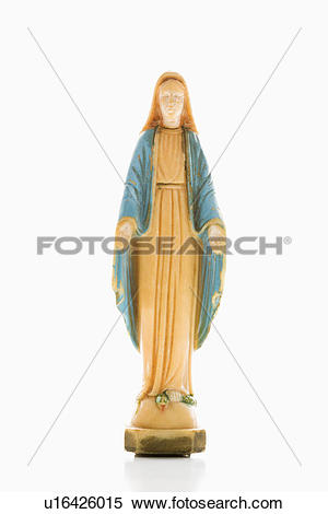 Stock Image of Virgin Mary statue with hands held out against.