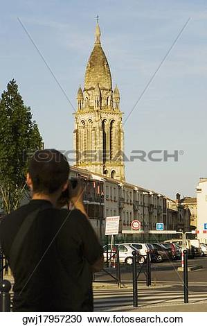 Stock Photography of Rear view of a man photographing a church.