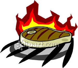 Steak On A Grill.