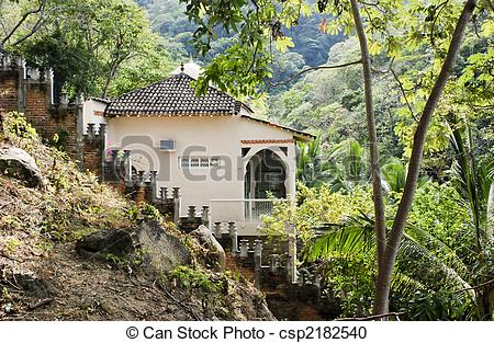 Stock Photography of House on a steep slope in a tropical jungle.