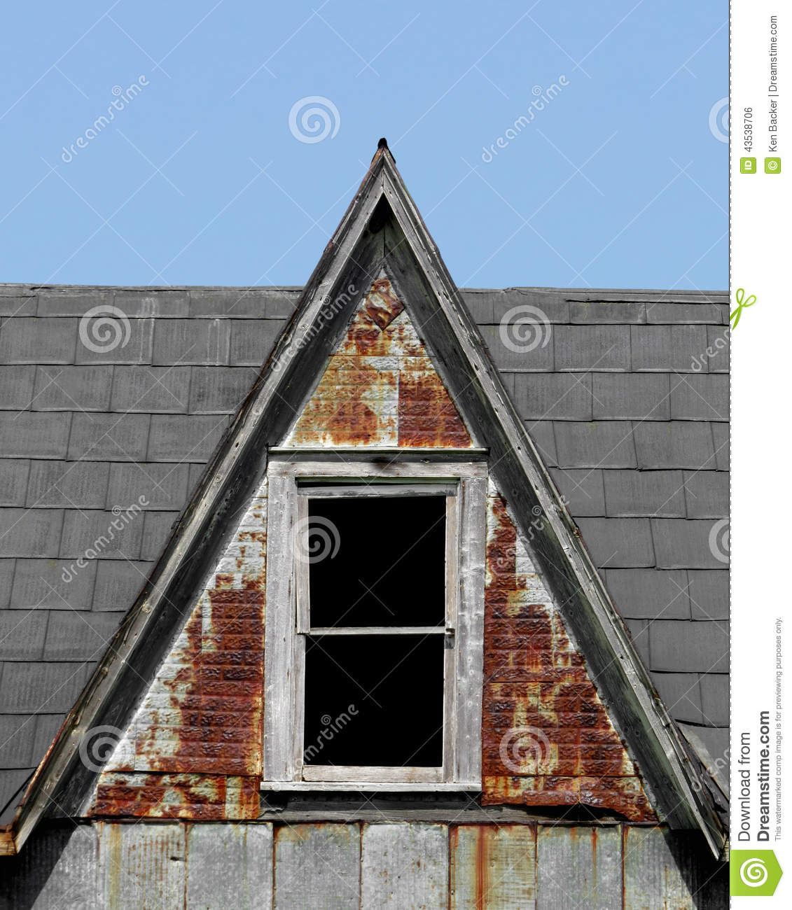 Old Steep Roof Dormer With Window. Stock Photo.