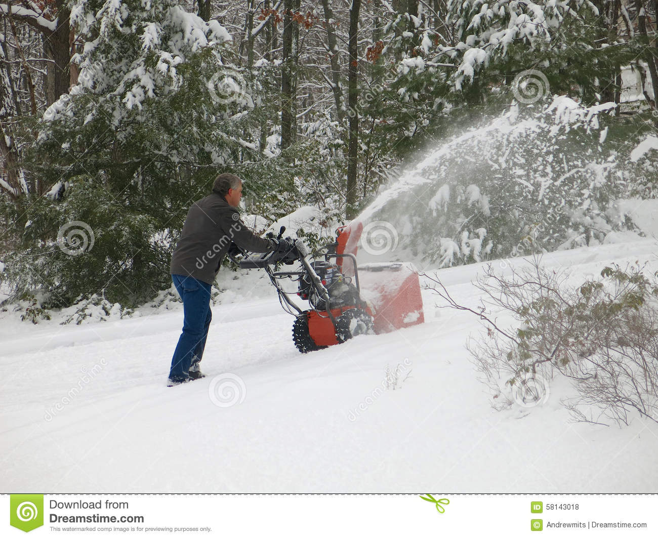 Throwing Snow On Steep Driveway Stock Photo.