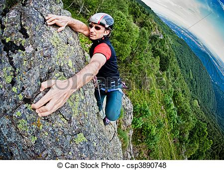 Pictures of Young white man climbing a steep wall in mountain.