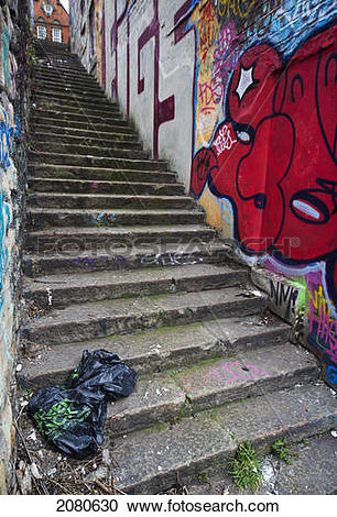 Stock Photography of Steep concrete steps with a graffiti covered.