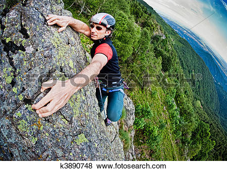 Pictures of Young white man climbing a steep wall k3890748.