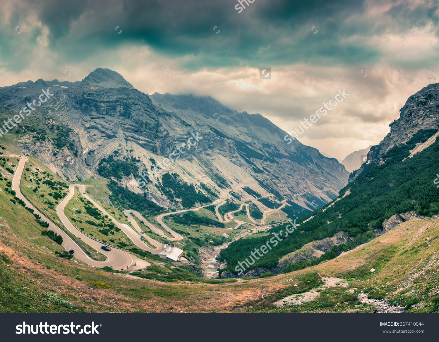 View From The Top Of Famous Italian Stelvio High Alpine Road.