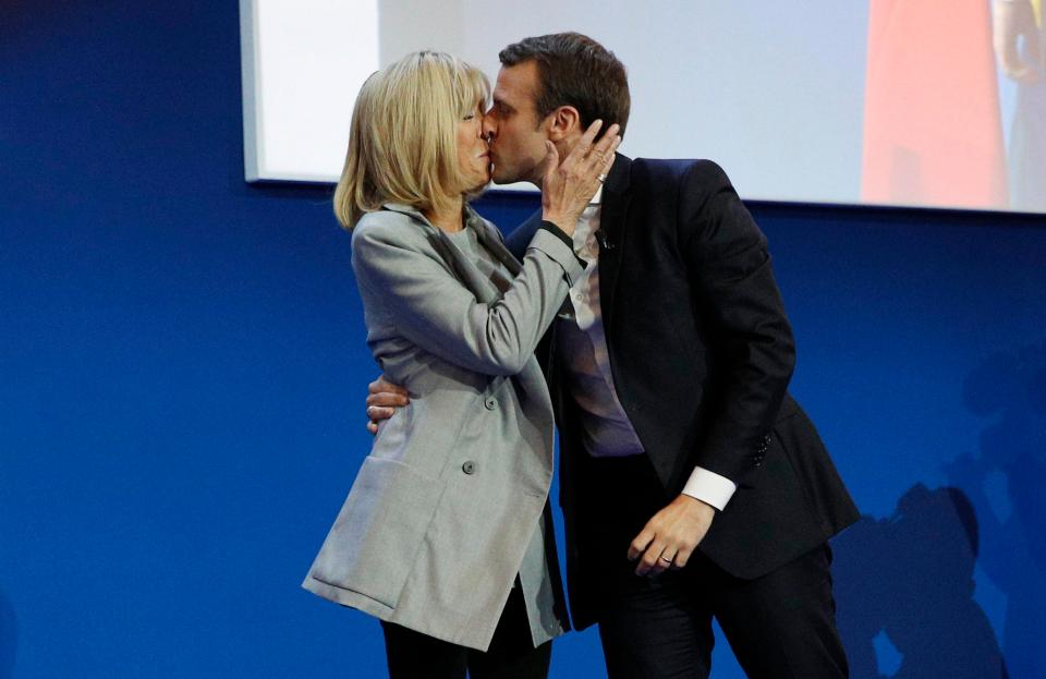 Moment French President Emmanuel Macron kissed future wife.