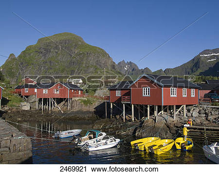 Stock Photography of Boats moored near stilt houses, Moskenesoya.