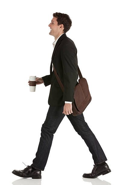 Businessman walking with a disposable cup stock photo.