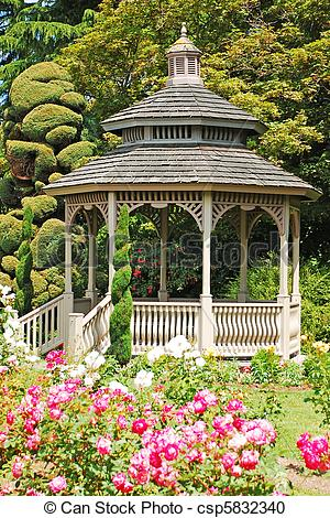 Stock Photography of Wooden gazebo in rose garden in spring.