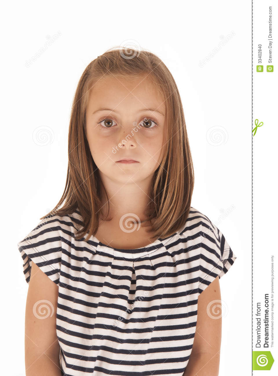 Young Girl With Big Eyes Stoic Expression Stock Photo.