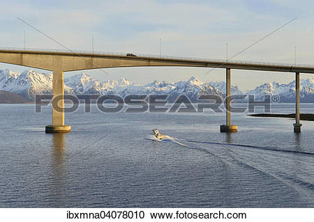 Stock Photography of Boat at the Hadsel bridge, behind the snow.