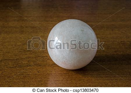Picture of Stone ball on the table.