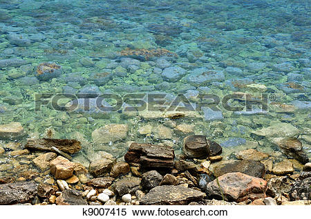 Stock Image of sea water stone beach background k9007415.