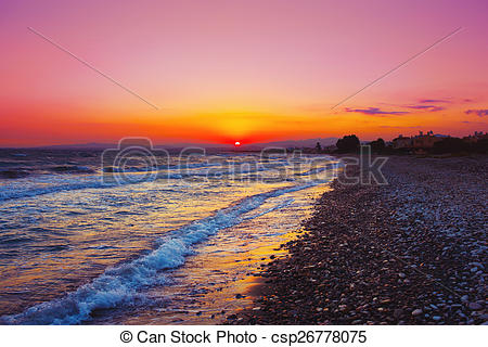 Picture of Beautuful sunset over Mediterranean sea. Cobble stone.