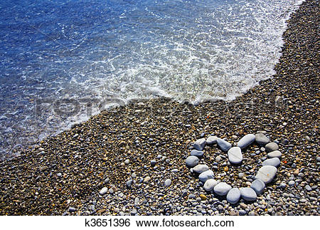 Stock Images of heart on stone beach k3651396.