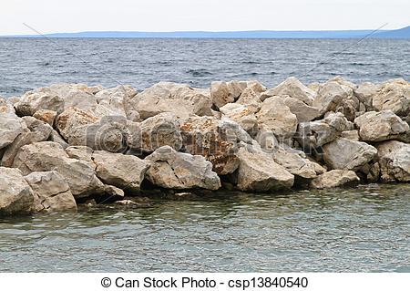 Stock Photo of Breakwater stone structure for coastal erosion.