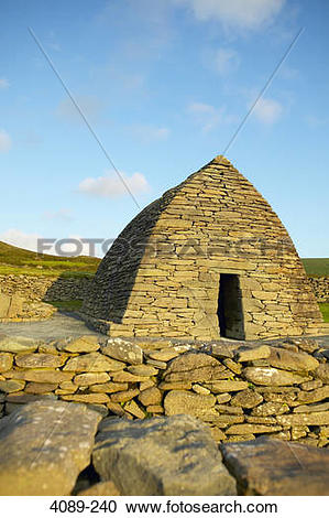 Stock Photography of Ruins of a stone church, Gallarus Oratory.