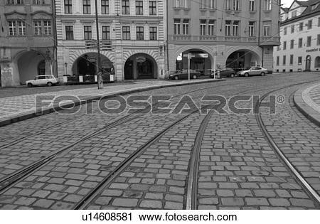 Stock Photography of Tram rail tracks running through cobbled.