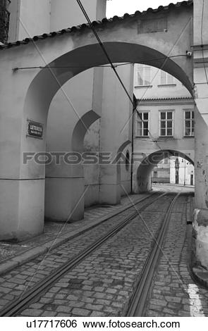 Stock Images of Tram rail tracks running through a cobbled stone.